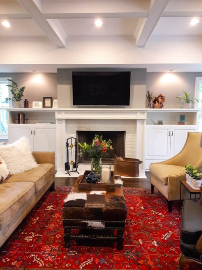 living room with custom fireplace built-ins furnished